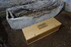 Original coffin and new box